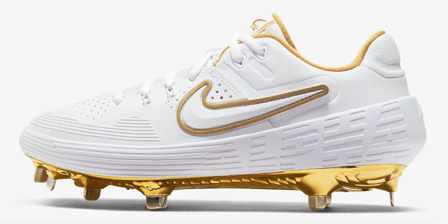 white and gold nike softball cleat